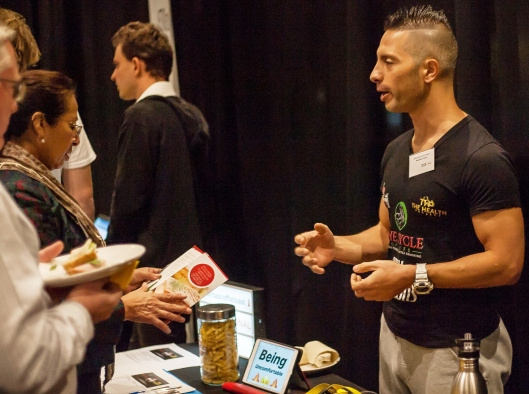 Alessandro Berenato from AB Functional Fitness talking with potential clients in Startup Alley